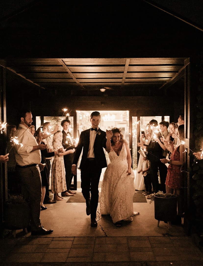 bride and groom exiting Glasshouse Venues